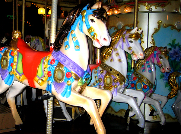 Painted ponies go up and down in the carousel of time