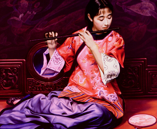 Girl blowing Chinese flute