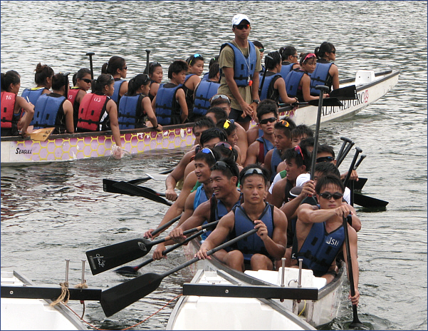 Students of the Singapore Institute of Management rowing during a Dragonboat competition in 2012
