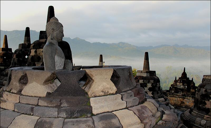 Lifesized Buddha statues in mindfulness meditation in Borobudur